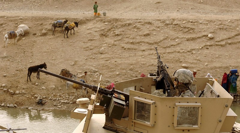 A U.S. Army Soldier from the Arizona Army National Guard provides site security from the turret of a humvee during a canal assessment mission with the Nangarhar Provincial Reconstruction Team in the Nangarhar province of Afghanistan. Credit: U.S. Air Force photo by Staff Sgt. Joshua T. Jasper.