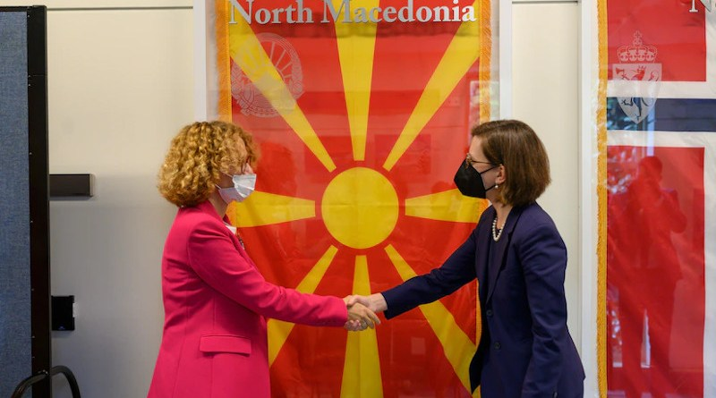 Performing the duties of assistant secretary of defense for international security affairs Laura Cooper and Republic of North Macedonia Minister of Defense Radmila Shekerinska share a congratulatory moment during the ceremony to unveil the flag of North Macedonia in the NATO Hallway at the Pentagon, Sept. 17, 2021. Photo Credit: Air Force Staff Sgt. Brittany A. Chase, DOD