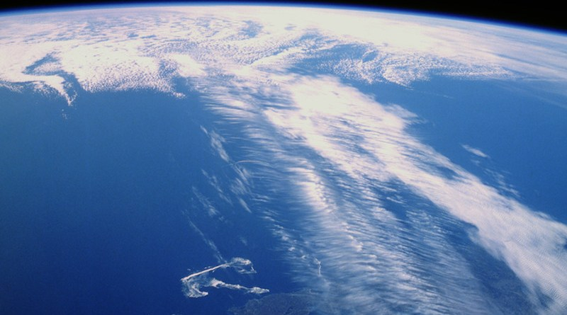 Clouds along a jet stream over Canada. Banded cirrus clouds running perpendicular to the jet stream—a telltale feature photographed by an astronaut aboard Space Shuttle Discovery. CREDIT: NASA