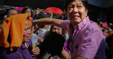 Former Philippine Sen. Ferdinand Marcos Jr. shakes hands with tourists during the Panagbenga Festival in the northern mountain resort city of Baguio, Feb. 24, 2018. Photo Credit: Jojo Riñoza/BenarNews