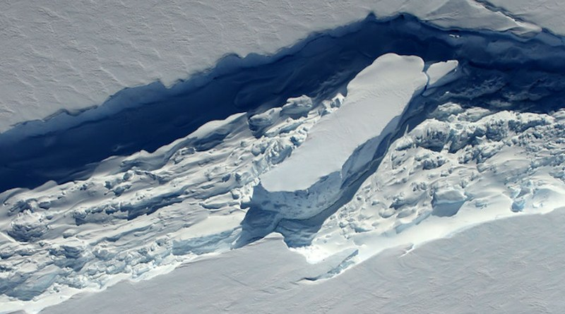 Ice melange, a combination of ice shelf fragments, windblown snow and frozen seawater, can act as a glue to fuse large rifts in floating ice in Antarctica. Researchers at UCI and NASA JPL found that a thinning of the substance over time can cause rifts to open, leading to the calving of large icebergs. CREDIT: Beck / NASA Operation IceBridge