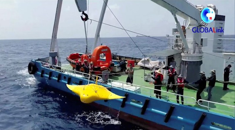 Chinese researchers from Northwestern Polytechnical University conduct a test swim of a manta ray-shaped robot in the waters off the Paracel Islands in the South China Sea, in early September 2021. [Courtesy Xinhua News Agency]
