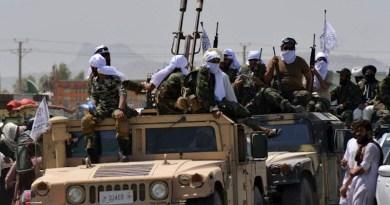 Taliban with a US military Humvee in Afghanistan. Photo via Social Media/Arab News