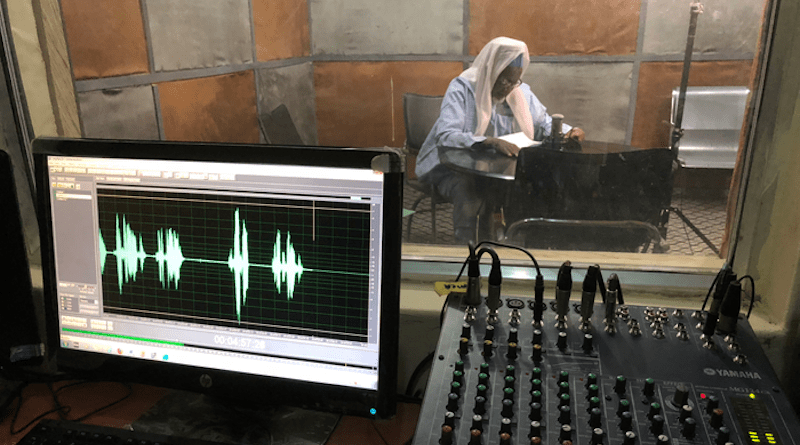 """Sheik Goni Muhammad Sa'ad Ngamdu, an Islamic leader in Maiduguri, records a message at the Kanem FM studios at the University of Maiduguri about Islamic tenets of forgiveness. In the message, he enjoins Muslims to accept repentant former members of Boko Haram who are returning home, in for research described in """"Trusted authorities can change minds and shift norms during conflict"""" published in Proceedings of the National Academy of Sciences, October 11 2021 CREDIT: Graeme Blair"""