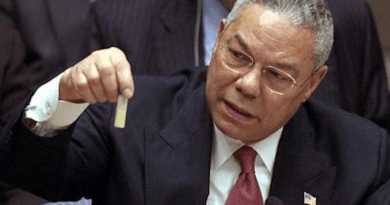 Colin Powell holding a model vial of anthrax while giving a presentation to the United Nations Security Council in February 2003. Photo Credit: United States Government, Wikipedia Commons