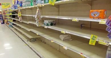 Empty supermarket shelves. Photo Credit: Daniel Case, Wikipedia Commons