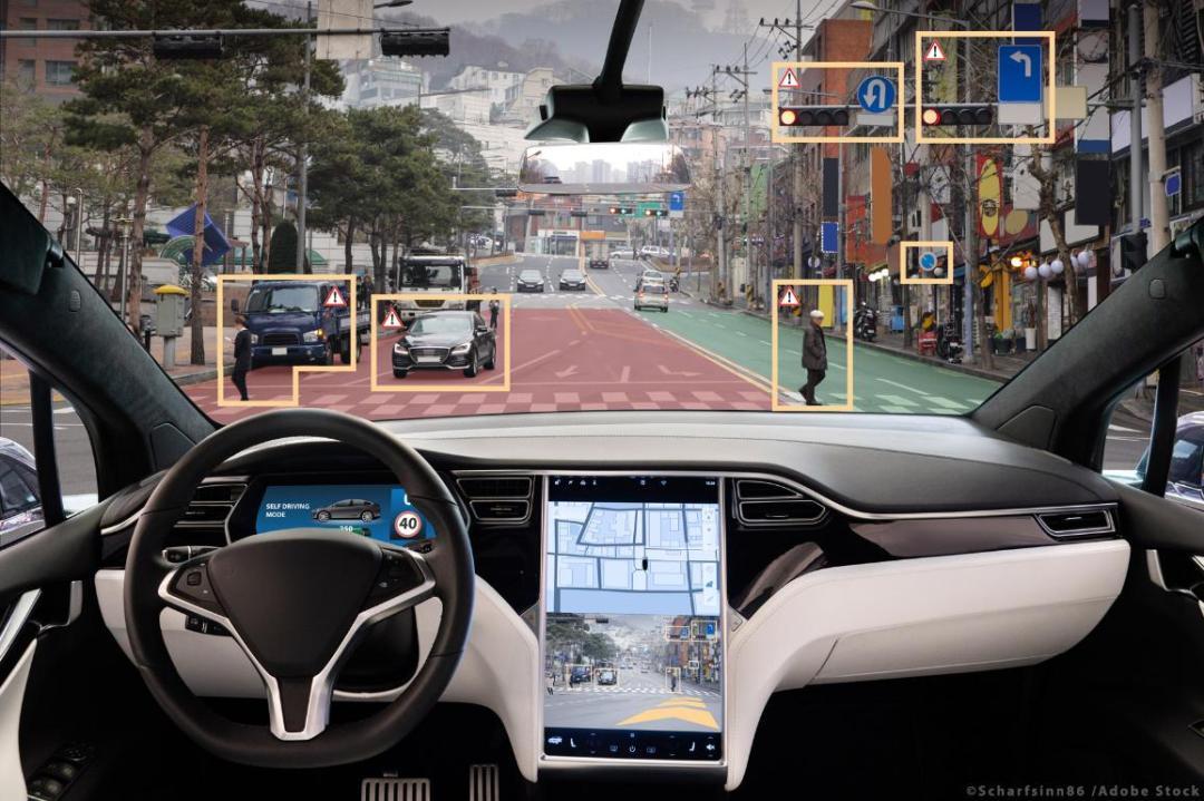 Self-driving vehicle on city street. ©AdobeStock/Scharfsinn86