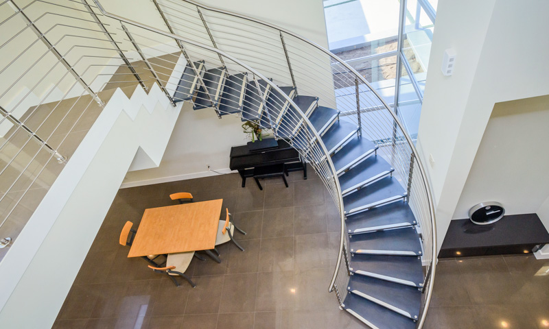 Custom Curved Staircase a Grand Solution for Modern Home