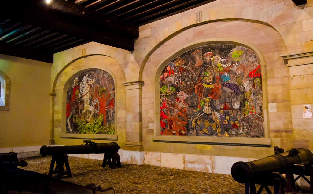 The Old Arsenal with original cannons from the 17th century and three (2 in picture) frescoes by Alexandre Cingria, depicting different periods in Geneva's history.