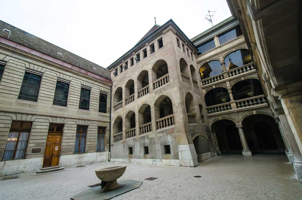 The beautiful square of the Geneva Town Hall that mixes antique and modern architecture in Geneva Old Town