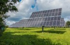 Hybrid solar panels: Some solar panels in a grass field