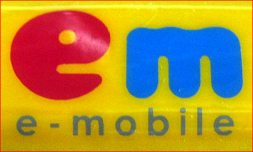 em = e-Mobile's interim logo (which was later changed)