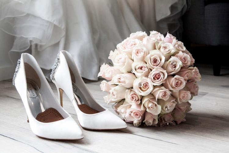a pair of shoes and flower bouquet