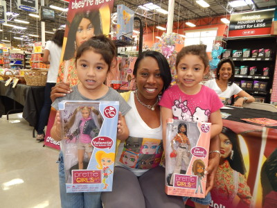The Pretty Girls designer, Stacey McBride, with fans of The One World Doll Project