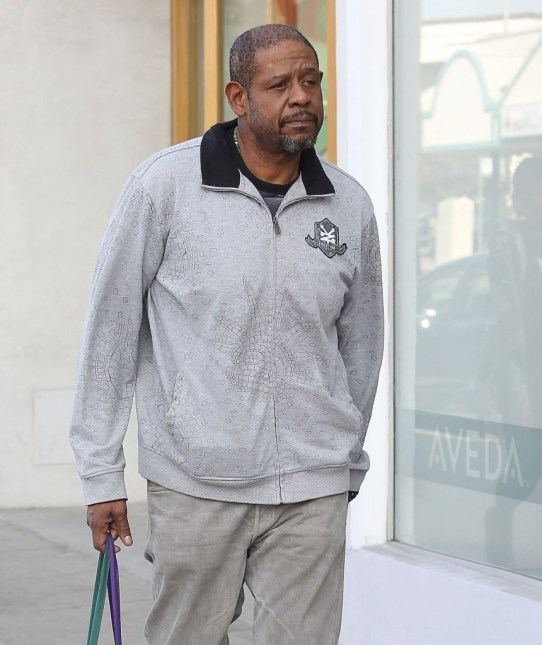 Forest Whitaker takes his daughters shopping at Urban Outfitters in Studio City, California on March 17, 2013