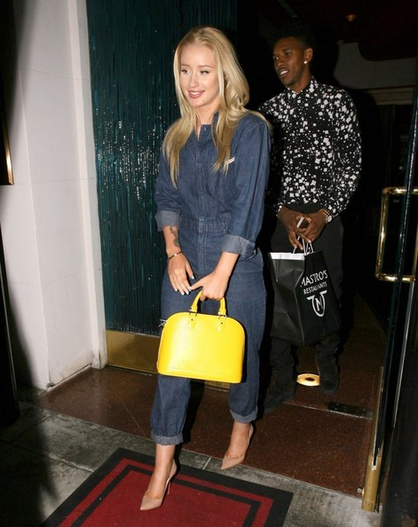 """Fancy"" rapper Iggy Azalea and her NBA star boyfriend Nick ""Swaggy P"" Young enjoy dinner together at Mastro's Steakhouse in Beverly Hills, California on July 16, 2014. Earlier in the evening the couple attended the 2014 ESPYs, where Iggy performed ahead of the event while Nick did a few red carpet interviews"