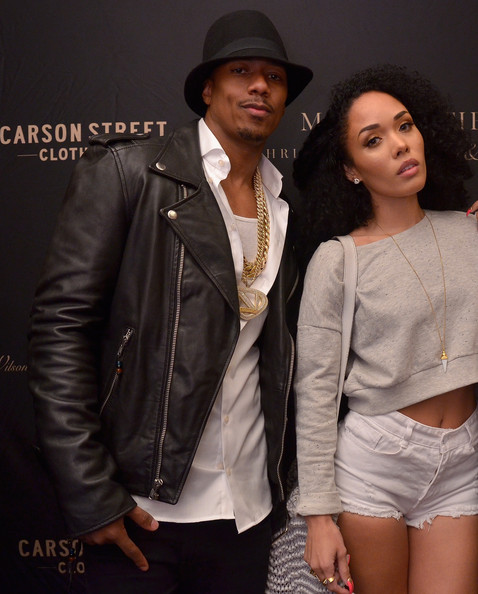 Actor Nick Cannon (L) and guest attend Chris Bosh and Hennessy V.S Raise a Glass to Mr. Nice Tie at Carson Street Clothiers on September 8, 2014 in New York City