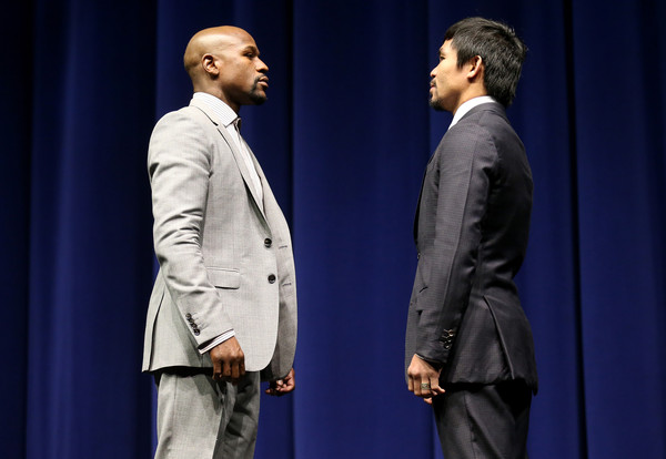 and manny pacquiao face off at the start of their press conference