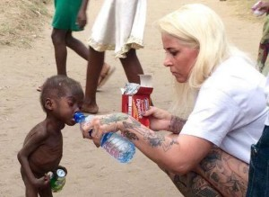 starving-child-being-fed-bottled-water