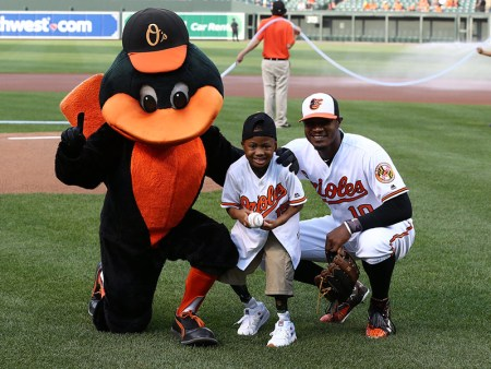 Zion Harvey with Adam Jones