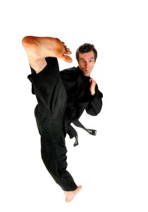 A photo of an instructor demonstrating a kick in one of our adults martial arts in Tameside classes