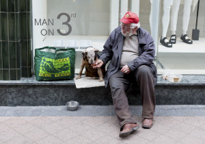 man with dog begging