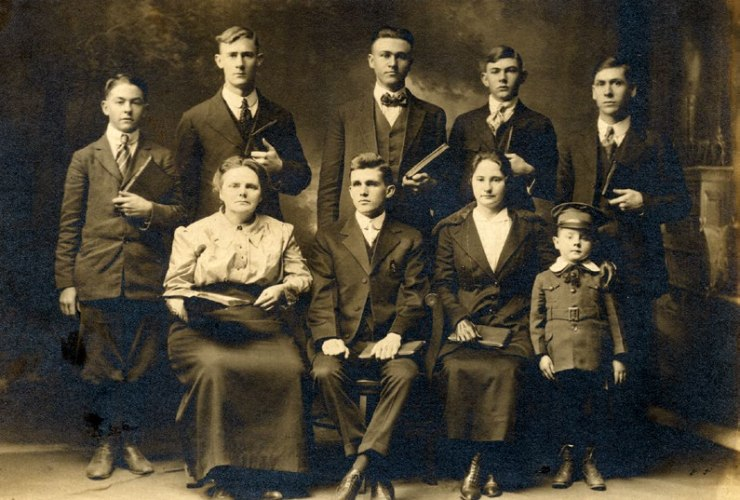 Nora Chambers, sitting with open Bible, and students attending the fall 1918 term of the Church of God Bible Training School