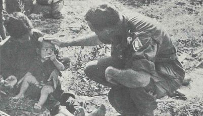 Church of God Chaplain Crick visits with some of the refugee children whom the Viet Cong have chased from their village.