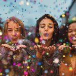 girls blowing confetti