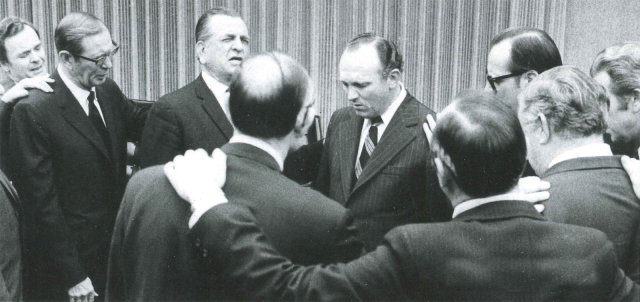 Installation prayer as Ray Hughes becomes general overseer, 1972