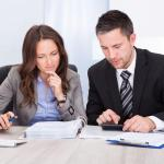 An Accountant from a CPA Firm Helps File a Client's Income Tax Return