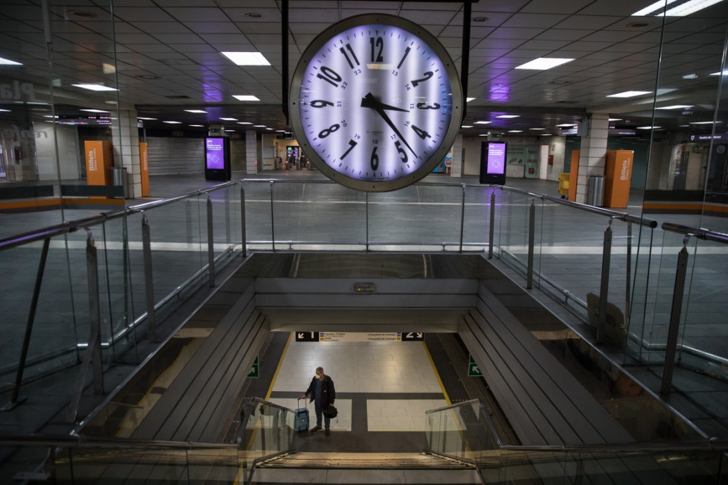 The central station of Catalonia Square is empty of passengers on the 10th day of confinement in Barcelona. It is 15h but just few people is using the trains to translate to the job.