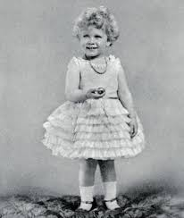 Princess Elizabeth, aged two, poses wearing a party dress