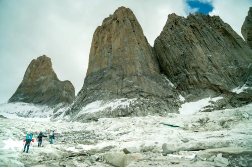 Sean Villanueva, Nico Favresse and Seibe Vanhee hike heavy loads to the base of the Central Tower. Torres del Paine, Patagonia.