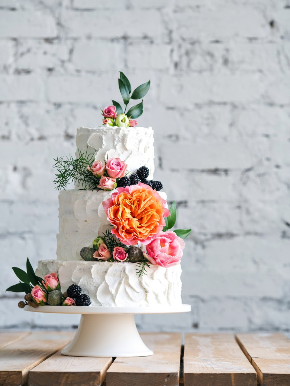 Vibrant Wedding Cake With Greenery