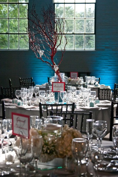 Red coral branch centerpieces blue uplighting hanging candles
