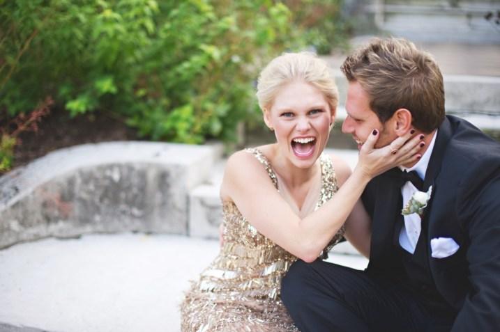 Happy bride in gold sequin gown