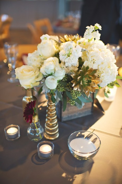 White and green flower centerpiece in wood box with gold succulents