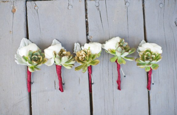 White dusty miller gold succulent and burgundy wrap boutonniere