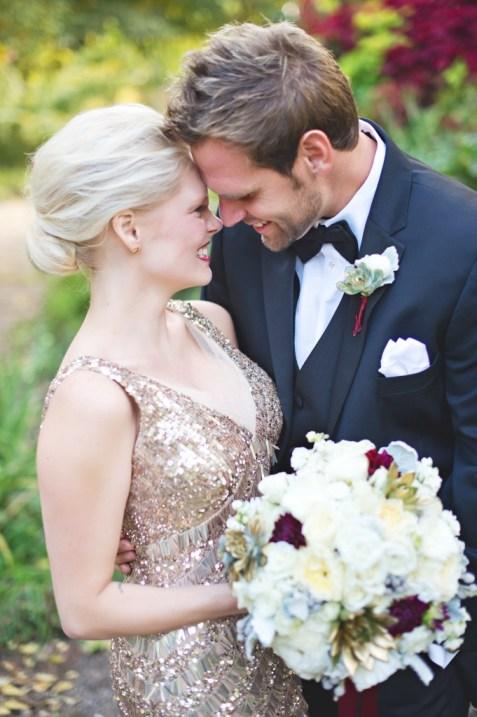 Bride and groom gold sequin dress and burgundy dahlias