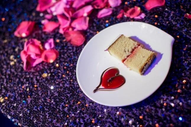 wedding cake pink sauce heart purple sequin tablecloth linen pink petals