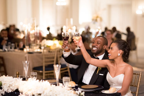 Bride & Groom toast at the Ritz Carlton St. Louis | Events Luxe Weddings