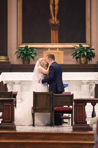 Bride & Groom Kiss at St. Louis Old Cathedral | St. Louis Weddings by Events Luxe