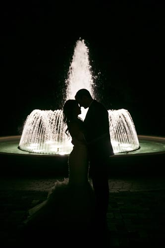 Bride & Groom kiss in front of fountain | St. Louis Weddings by Events Luxe