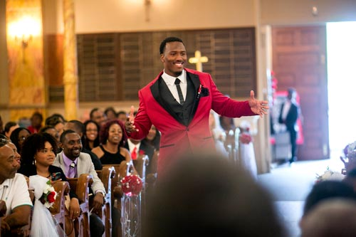 Red Tux Groom at St Stanislaus Catholic Church | Events Luxe Wedding