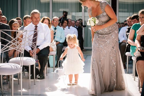 Flower girl walking down the aisle | Events Luxe Weddings