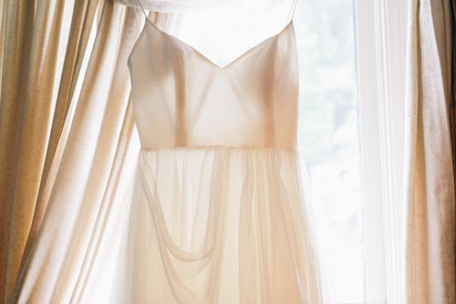 Wedding dress in window | Events Luxe Weddings