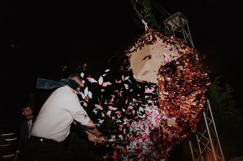 wedding guest takes a shot at the pinata | Events Luxe Weddings