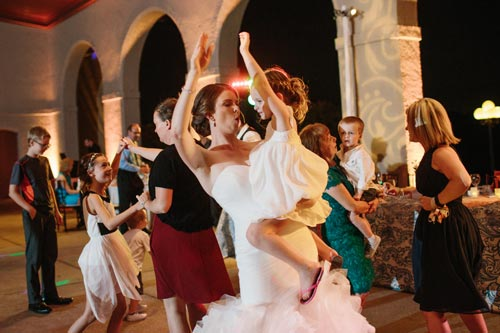 Bride and flower girl dancing at World's Fair Pavilion Wedding | Events Luxe Weddings
