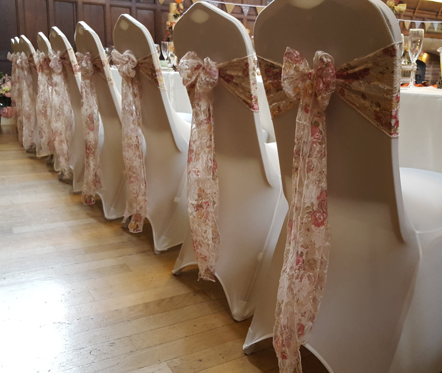 chair cover and sash hire birmingham office piston wedding covers sashes floral lace for top table